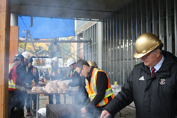 'Topping-Off' Barbecue Marks Milestone in the Construction of Manrell Hall